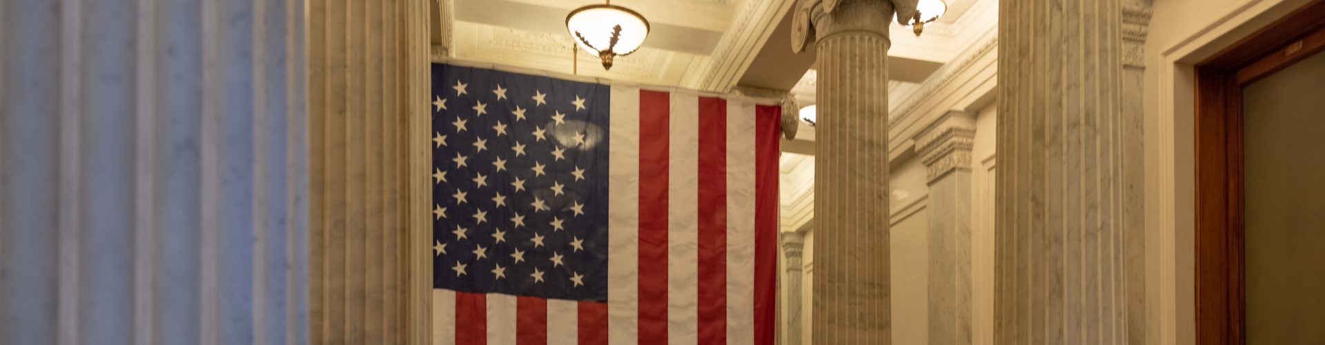 A US flag hanging at the corridor ceiling of US Capitol corridor ceiling, Interior, Washington DC.