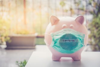 Piggy bank with Face Mask, Financial crisis and market crash due to virus spread.