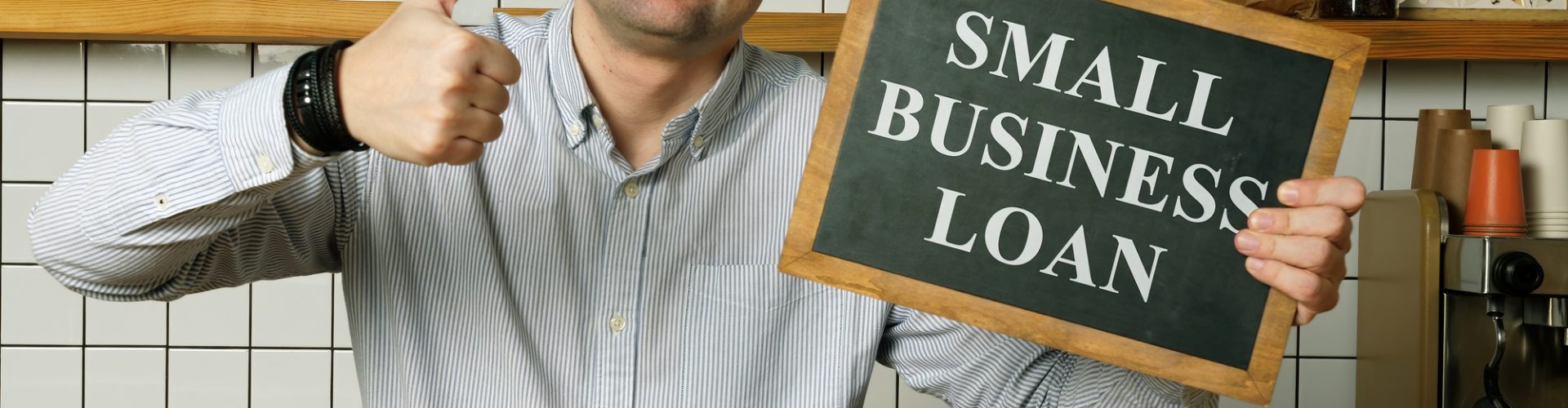 Small business loan in the businessman hands.