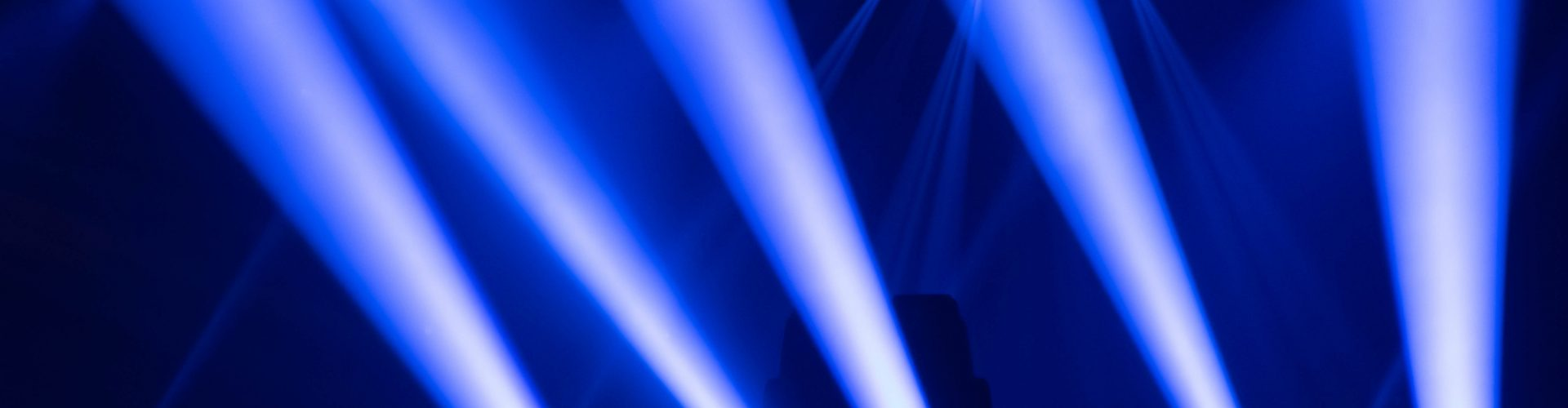 Scene, stage lights with colored spotlights and smoke, laser lights background, white and blue